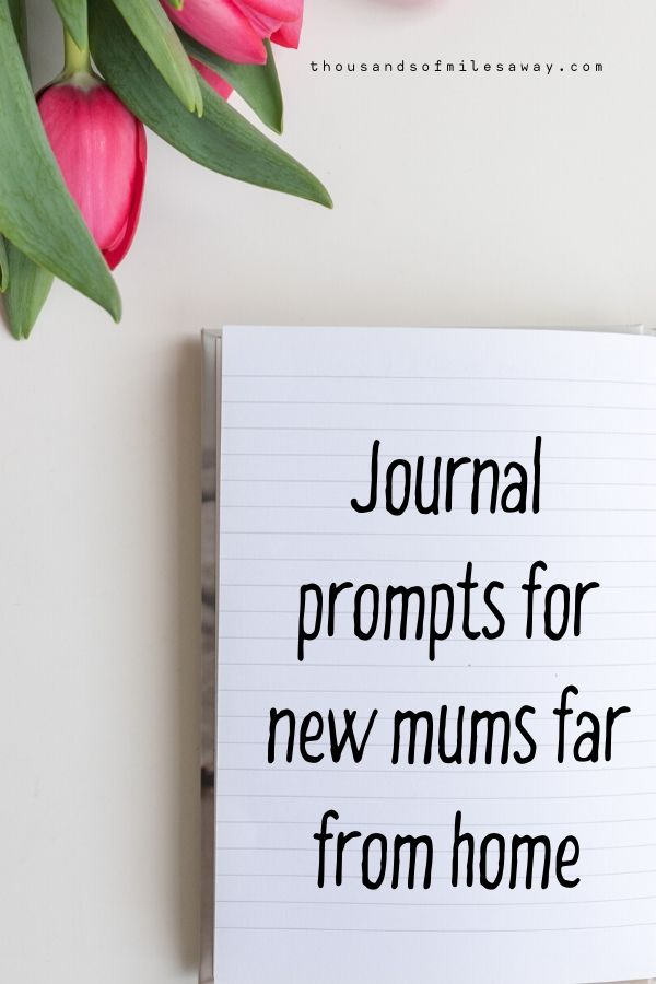 Some tulips and an open diary with writing 'journal prompts for new mums far from hom'